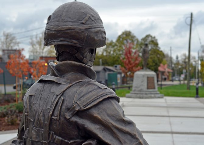 The sculpture is positioned so that the soldier is looking at the WWI monument and cenotaph, site of Remembrance ceremonies in St Thomas, Ont.